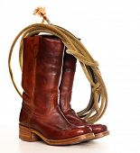 foto of wrangler  -  vertical image of a pair of brown cowboy boots and a Lasso on a white background - JPG