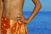 stock photo of pierced belly button  - beach wrap - JPG
