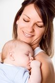 pic of sleeping baby  - new mom holding her newborn baby boy - JPG