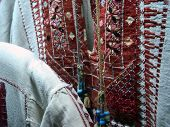 picture of handloom  - detail of traditional jordan clothes in a shop at amman - JPG