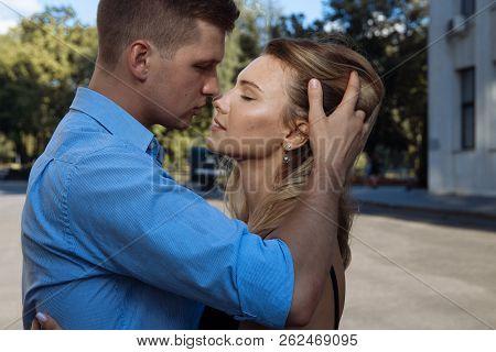 A Man Hugs A Girl