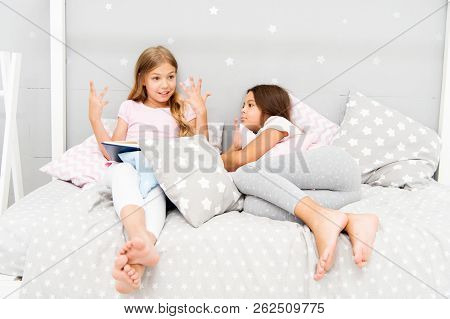 Children Read Book In Bed