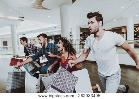 Company Of Friends Shopping In