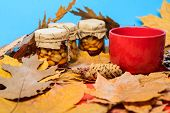 Set Three Honey Natural Sweets In Jars And Mug Of Tea Background Covered Fallen Leaves. Natural Home poster