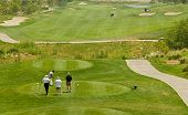 picture of foursome  - The exclusive golf resort and the players in action - JPG