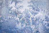 Winter Ice Pattern On The Frozen Window. Texture, Background For Inserting Text. New Year Theme. Win poster