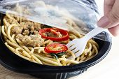 Take-away Food Ready Meal: Woman Hands Holding Fork And Open Cling Wrap With Take Out Food In Plasti poster