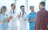 group of doctors congratulating the patient on his recovery poster