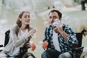 Disabled People On Wheelchairs Have Fun In Park. Disabled Young Man. Woman On Wheelchair. Relaxing I poster