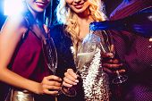Cropped View Of Man Pouring Champagne From Bottle Into Glasses For Glamor Girls poster