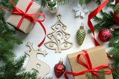 New Year. Christmas Wooden White Background With Christmas Tree Branches And Christmas Decorations.  poster