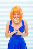 Crazy Girl In Playful Mood. Happy Pinup Model With Lollipop In Hand. Fashion Girl With Orange Hair H poster
