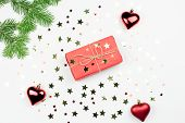 Red Giftbox With Golden Christmas Decorations Close Up poster