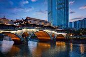 Famous landmark of Chengdu - Anshun bridge over Jin River illuminated at night, Chengdue, Sichuan ,  poster