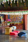 image of seoraksan  - prayer in the buddhist Sinheungsa Temple in Seoraksan National Park - JPG