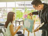 Handsome Young Asian Man Or Water Color Artist Teaching How To Paint And Artist Student Learning The poster