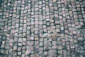 Постер, плакат: Granite Cobble Stoned Pavement Background Stone Pavement Texture Abstract Background Of Old Cobble