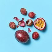 Composition of passion fruit litchi and fruit peel on a blue background with copy space. Tropical he poster