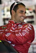 HAMPTON, GA - MAR 5: Juan Pablo Montoya gets in his car during practice for the Kobalt Tools 500 at