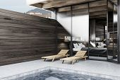 Corner Of Private Pool With Dark Wooden Walls, Deck Chairs, And Bedroom In The Background. Luxury Li poster
