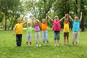 picture of children playing  - Group of children having fun together in the park - JPG