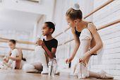 Young Girls Preparing For Ballet Training Indoors. Classical Ballet. Girl In Balerina Tutu. Training poster