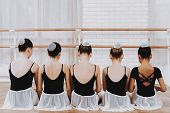 Young Girls Resting After Ballet Training Indoor. Classical Ballet. Girl In Balerina Tutu. Training  poster