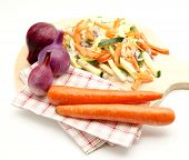 foto of crudites  - Assorted vegetables cut on a wood table surrounded by white background - JPG