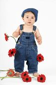 pic of country girl  - standing nine mth old baby girl wearing a bib n brace denim overalls - JPG