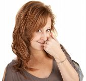 stock photo of gullible  - Shy young woman with hand near mouth over white background - JPG