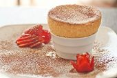 Yummy Souffle with Strawberries white plate
