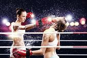 Two women boxing in ring