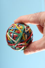 stock photo of rubber band  - a elastic ball on a blue background - JPG