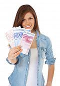 stock photo of scandinavian descent  - Attractive teenage girl holding 150 euro - JPG