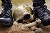 stock photo of doomsday  - Victory and war abstract with skull and military shoes - JPG