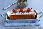 picture of pound cake  - pound cake with powdered sugar and berries