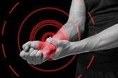 picture of stiff  - Pain in a male wrist - JPG