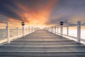 pic of sea-scape  - old wood bridg pier with nobody against beautiful dusky sky use for natural background backdrop and multipurpose sea scene - JPG