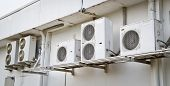 pic of air compressor  - Air conditioner compressor on the wall in Thailand - JPG
