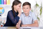 stock photo of pre-adolescent child  - Portrait of a school child making learning during lesson at school - JPG