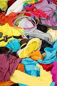 foto of untidiness  - Untidy cluttered wardrobe with colorful clothes and accessories - JPG