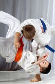 image of judo  - Training judo throw sportsman in judogi and with blue belt - JPG
