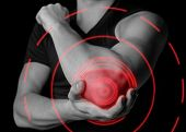 foto of elbow  - Man holds his the elbow joint acute pain in the elbow black and white image pain area of red color - JPG