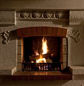 picture of cozy hearth  - The Fire and firewood in old fireplace - JPG