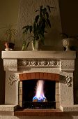 stock photo of cozy hearth  - The Fire and firewood in old fireplace - JPG