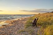 stock photo of stroll  - Hiker takes a break from the journey to take a stroll on the beach - JPG