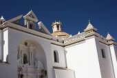 stock photo of senora  - Detail of the facade of the Basilica of Our Lady of Copacabana in the small tourist town along the Titicaca Lake in Copacabana Bolivia - JPG
