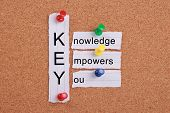 image of empower  - Knowledge Empowers You concept pinned on cork board - JPG