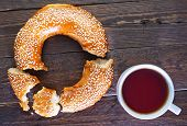 stock photo of bagel  - fresh tea with bagel on a table - JPG