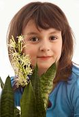 picture of sansevieria  - Smiling little girl with blooming home plant Sansevieria - JPG
